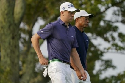 Justin Thomas, of the United States, and Tiger Woods, of the United States, walk off the second tee during the first round of the US Open Golf Championship, Thursday, Sept. 17, 2020, in Mamaroneck, N.Y. (AP Photo/John Minchillo)