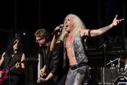 "In this Sept. 2, 2016, file photo, Dee Snider from the band Twisted Sister performs on the Fox News Channel's ""Fox & Friends"" show, in New York. Snider took to social media to condemn anti-maskers who went into a Florida Target store blaring the group's hit ""We're Not Gonna Take …"