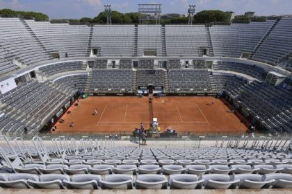 The stands around the Central Court of the Foro Italico are empty during a match between Serbia's Novak Djokovic and Italy's Salvatore Caruso, at the Italian Open tennis tournament in Rome, Wednesday, Sept. 16, 2020. The tournament at the Foro Italico was rescheduled from May because of the pandemic and …