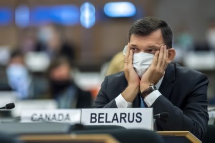 Yury Ambrazevich, Head of Belarus' delegation and Permanent Representative to the UN Office, listen to the speeches, during the opening of 45th session of the Human Rights Council, at the European headquarters of the United Nations in Geneva, Switzerland, Monday, September 14, 2020. (Martial Trezzini/Keystone via AP)
