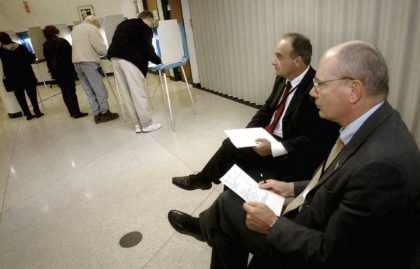 In this Nov. 2, 2004, file photo, parliamentarians Goran Lennmarker, right, of Sweden and Stavros Evagorow, of Cyprus, observe the American voting process as voters cast their ballots at Robbinsdale City Hall in Robbinsdale, Minn. The two men are members of the Organization for Security and Cooperation in Europe. Officials …