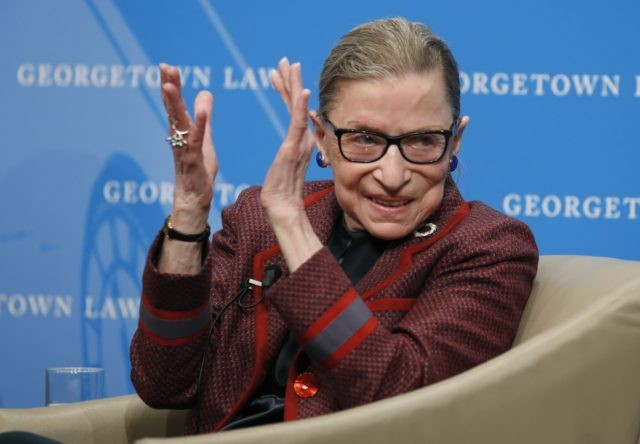 In this April 6, 2018, file photo, Supreme Court Justice Ruth Bader Ginsburg applauds after a performance in her honor after she spoke about her life and work during a discussion at Georgetown Law School in Washington. The Supreme Court says Ginsburg has died of metastatic pancreatic cancer at age …