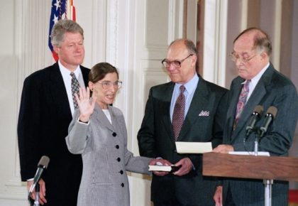 In this Aug. 10, 1993, file photo, Supreme Court Justice Ruth Bader Ginsburg takes the court oath from Chief Justice William Rehnquist, right, during a ceremony in the East Room of the White House in Washington. Ginsburg's husband Martin holds the Bible and President Bill Clinton watches at left. The …