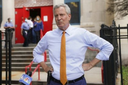 In this Aug. 19, 2020, file photo, New York Mayor Bill de Blasio speaks to reporters after visiting New Bridges Elementary School in the Brooklyn borough of New York, to observe pandemic-related safety procedures. In a Sept. 10, 2020, letter to the mayor by the leaders of a number of …