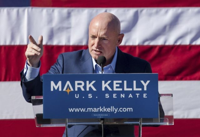 In this Feb. 23, 2019, file photo, Mark Kelly speaks during his senate campaign kickoff event in Tucson, Ariz. Arizona will be in the national spotlight in November as a presidential battleground and the home of one of the most closely watched Senate contests in the country. But Tuesday's primary …