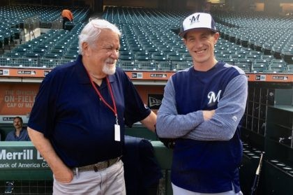 In this Aug. 21, 2017, photo, baseball scout Gary Hughes, left, talks with Milwaukee Brewers managers Craig Counsell before a baseball game in San Francisco. Hughes' son, Michael, is married to Counsell's sister. Hughes, a beloved longtime professional scout for numerous big league organizations during a 54-year career, has died …