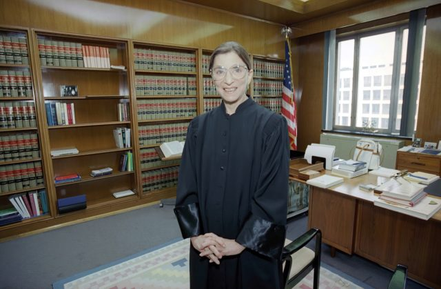 In this Aug. 3, 1993, file photo, then-Judge Ruth Bader Ginsburg poses in her robe in her office at U.S. District Court in Washington. Earlier, the Senate voted 96-3 to confirm Bader as the 107th justice and the second woman to serve on the Supreme Court. Ruth Bader Ginsburg died …