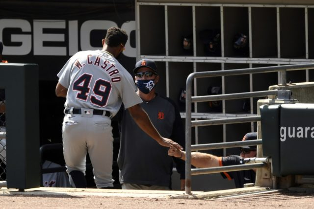 Detroit Tigers' Willi Castro (49) celebrates with manager Ron Gardenhire, right, in the dugout after scoring on a Jorge Bonifacio single during the first inning of a baseball game against the Chicago White Sox, Sunday, Sept. 13, 2020, in Chicago. (AP Photo/Paul Beaty)