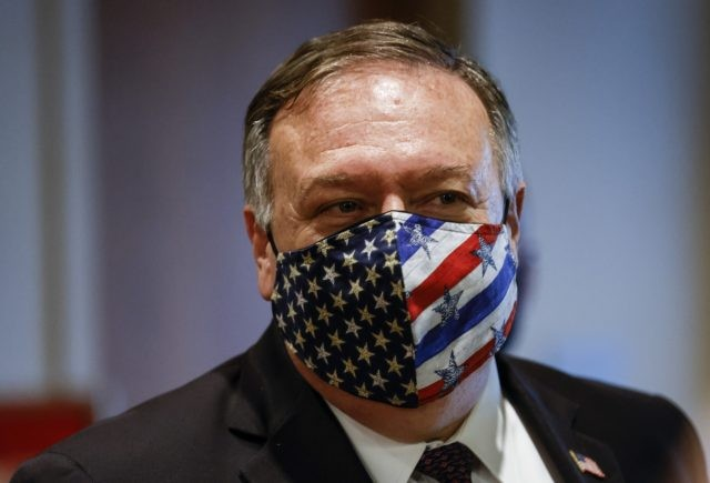 In this Aug. 20, 2020 file photo Secretary of State Mike Pompeo departs a meeting with members of the U.N. Security Council about Iran's alleged non-compliance with a nuclear deal at the United Nation in New York. The Trump administration has declared that all U.N. sanctions against Iran have been …