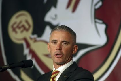 In this Dec. 8, 2019, file photo, Florida State head football coach Mike Norvell speaks at n during an NCAA college football press conference in Tallahassee, Fla. Norvell has tested positive for COVID-19 and will not coach the Seminoles in-person this week as they prepare for Miami. He released a …