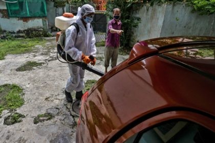 A civic staff in protective suit disinfects the parking area of an apartment where one of the residents tested positive for COVID-19 in Kolkata, India, Tuesday, Sept. 22, 2020. The nation of 1.3 billion people is expected to become the coronavirus pandemic's worst-hit country within weeks, surpassing the United States. …