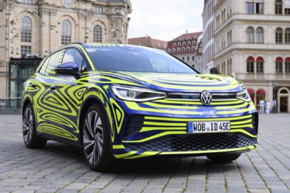 In this July 29, 2020 file photo, a VW ID.4 stands in front of the Frauenkirche on the occasion of a Volkswagen vehicle presentation on the Neumarkt in Dresden, Germany. Germany's Volkswagen is unveiling the ID.4, the battery-powered sport-utility vehicle that is headed for global markets including the United States …
