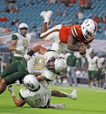 Miami quarterback D'Eriq King (1) leaps for a second-quarter touchdown against UAB during an NCAA college football game in Miami Gardens, Fla., Thursday, Sept. 10, 2020. King will lead Miami against Florida State Saturday, Sept. 26, 2020. (Al Diaz/Miami Herald via AP, File)