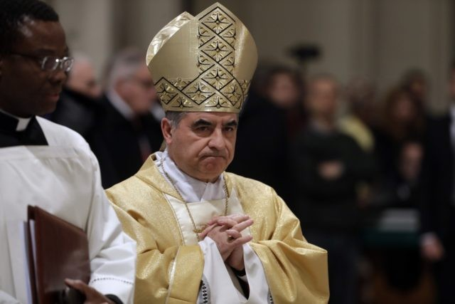 In this Feb. 9, 2017 file photo, Mons. Giovanni Angelo Becciu presides over an eucharistic liturgy, at the St. John in Latheran Basilica, in Rome. The powerful head of the Vatican's saint-making office, Cardinal Angelo Becciu, has resigned from the post and renounced his rights as a cardinal amid a …
