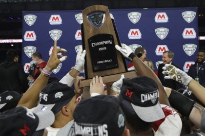 d In this Dec. 7, 2019, file photo, members of the Miami of Ohio team hold the champion trophy after the Mid-American Conference championship NCAA college football game against Central Michigan in Detroit. The Mid-American Conference announced Friday, Sept. 25, 2020, that it will have a 6-game football season, meaning …