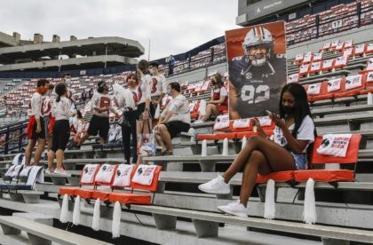 Auburn students are socially distanced as they wait the start of an NCAA college football game against Kentucky on Saturday, September 26, 2020 in Auburn, Alabama. (AP Photo/Butch Dill)