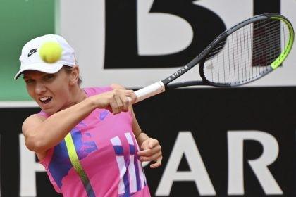 Romania's Simona Halep returns the ball to Czech Republic's Karolina Pliskova during their final match at the Italian Open tennis tournament, in Rome, Monday, Sept. 21, 2020. (Alfredo Falcone/LaPresse via AP)