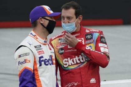 Denny Hamlin, left, and Kyle Busch talk before the NASCAR Cup Series auto race Saturday, Sept. 19, 2020, in Bristol, Tenn. (AP Photo/Steve Helber)
