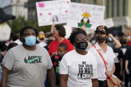 Black Lives Matter protesters march, Friday, Sept. 25, 2020, in Louisville. Breonna Taylor's family demanded Friday that Kentucky authorities release all body camera footage, police files and the transcripts of the grand jury hearings that led to no charges against police officers who killed the Black woman during a March …