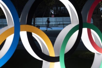 In this March 30, 2020, file photo, a man jogs past the Olympic rings in Tokyo.It's been six months since the Tokyo Olympics were postponed until next year by the COVID-19 pandemic. Everyone from new Japan Prime Minister Yoshihide Suga to IOC President Thomas Bach have tried to assure the …