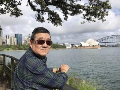 This March 2020 photo provided by the family shows Ming Wang in Sydney, Australia. The 71-year-old was sickened in March on a cruise from Australia with his wife, a break after decades of running the family's Chinese restaurant in Papillion, Neb. In the 74 days he was hospitalized, doctors desperately …