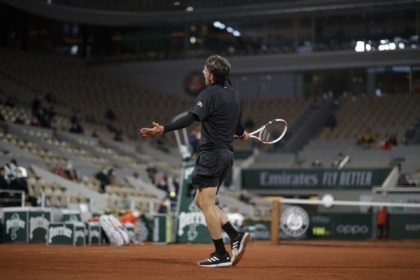 Austria's Dominic Thiem reacts in the first round match of the French Open tennis tournament against Croatia's Marin Cilic at the Roland Garros stadium in Paris, France, Monday, Sept. 28, 2020. (AP Photo/Alessandra Tarantino)