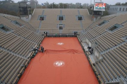 View of the empty seats on Suzanne Lenglen court as rain suspended most matches in the first round of the French Open tennis tournament at the Roland Garros stadium in Paris, France, Monday, Sept. 28, 2020. (AP Photo/Michel Euler)