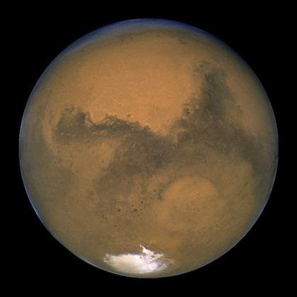 This Aug. 26, 2003 image made available by NASA shows Mars as it lines up with the Sun and the Earth. Photographed by the Hubble Space Telescope, it was about 55.8 million kilometers (34.6 million miles) from Earth. A network of salty ponds may be gurgling beneath Mars' South Pole …