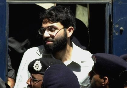 In this March 29, 2002, file photo, Ahmed Omar Saeed Sheikh, the alleged mastermind behind the Wall Street Journal reporter Daniel Pearl's kidnap-slaying, appears at the court in Karachi, Pakistan. Pakistan's Supreme Court is to hear an appeal Monday, Sept. 28, 2020, by the family of slain American journalist Daniel …