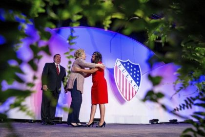 In this July 14, 2016 photo Democratic presidential candidate Hillary Clinton, accompanied by then-LULAC President Roger C. Rocha, Jr., left, hugs University of Texas student Dreamer Lizeth Urdiales, right, as she arrives to speaks at the 87th League of United Latin American Citizens National Convention at the Washington Hilton in …