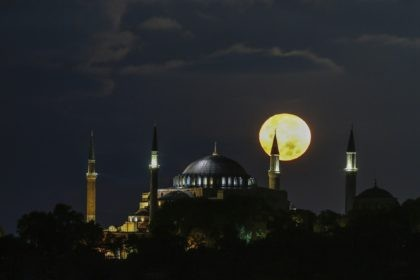 The full moon rises behind the Byzantine-era Hagia Sophia in the historic Sultanahmet district of Istanbul, early Tuesday, Sept. 1, 2020. Worshipers held the first Muslim prayers in 86 years inside the Istanbul landmark that served as one of Christendom's most significant cathedrals, a mosque and a museum before its …