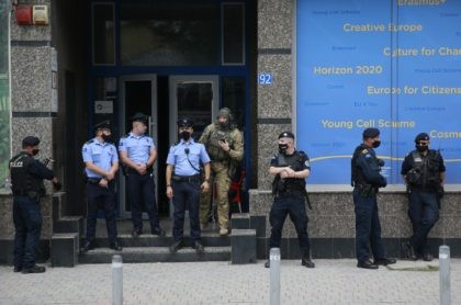 Kosovo police guard the entrance of the offices of a war veterans association in Kosovo, in Pristina, Friday, Sept. 25, 2020. Witnesses say European Union security police have stormed the offices of a war veterans association in Kosovo. The association represents the former ethnic Albanian separatists who fought Serbian troops …