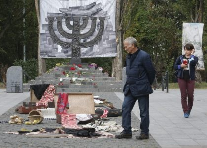 People look an art installation to mark 79th anniversary of the 1941 Babi Yar massacre at a menorah monument close to a Babi Yar ravine where tens of thousands of Jews were killed during WWII, in Kyiv, Ukraine, Tuesday, Sept. 29, 2020. Ukraine marked the 79th anniversary of the 1941 …