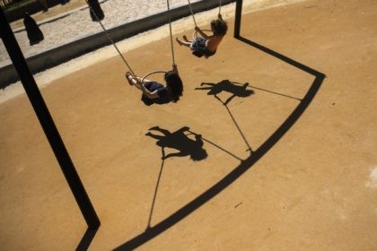 In this Thursday, May 28, 2020 file photo, children swing in a playground at Leopold park during the partial lifting of coronavirus, COVID-19, lockdown regulations in Brussels. The European Union's external auditor said Tuesday, Sept. 29, 2020 that child poverty has reached worrying levels across the world's largest economy, and …