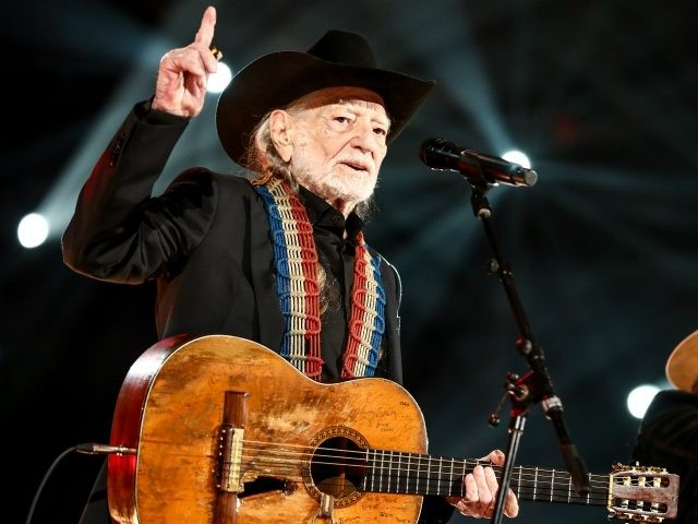 LOS ANGELES, CALIFORNIA - FEBRUARY 08: Willie Nelson performs at MusiCares Person of the Year honoring Dolly Parton at Los Angeles Convention Center on February 08, 2019 in Los Angeles, California. (Photo by Rich Fury/Getty Images for The Recording Academy)