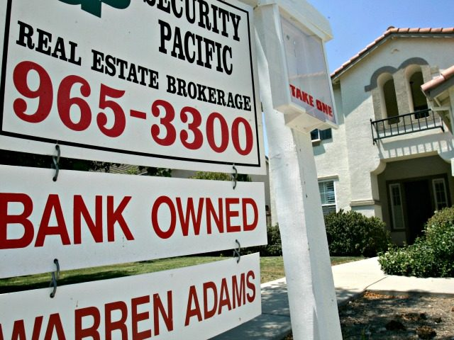 In this July 2, 2008 file photo, a bank owned home is seen for sale in Sacramento, Calif.. Rescue legislation sailed through the House Wednesday, July 23, 2008, aimed at helping 400,000 strapped homeowners avoid foreclosure and to prevent troubled mortgage giants Fannie Mae and Freddie Mac from collapsing. (AP …