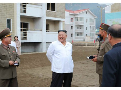 North Korea: dictator Kim Jong-un (and sister Kim Yo-jong, in the background) visit flooded locations (Rodong Sinmun)