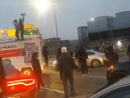 """Black Education"" protest shuts down Washington, D.C. freeway during Monday morning rush hour traffic. (Twitter Video Screenshot/@BenediGarcia3)"