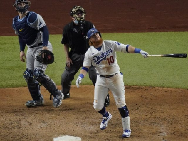Major League Baseball says Justin Turner violated protocols when he returned to field