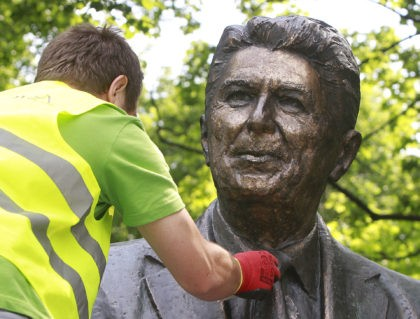 Cleaner Adam Gawronski polishes the bronze monument of former U.S. President Ronald Reagan in downtown Warsaw, Poland, on Friday, June 3, 2016, ahead of the NATO summit to be held in Warsaw in July, to be attended by President Barack Obama, and ahead of the June 5 anniversary of Reagan's …