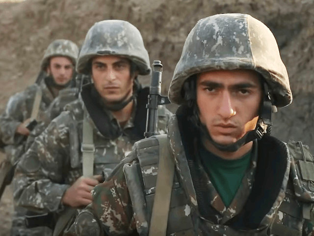 """In this image taken from video released by the Armenian Defense Ministry on Wednesday, Sept. 30, 2020, Armenian solders guard their position in the self-proclaimed Republic of Nagorno-Karabakh, Azerbaijan. Armenia's Foreign Ministry in a statement """"completely"""" denied reports of shelling the Dashkesan region and said that with those reports Azerbaijan …"""