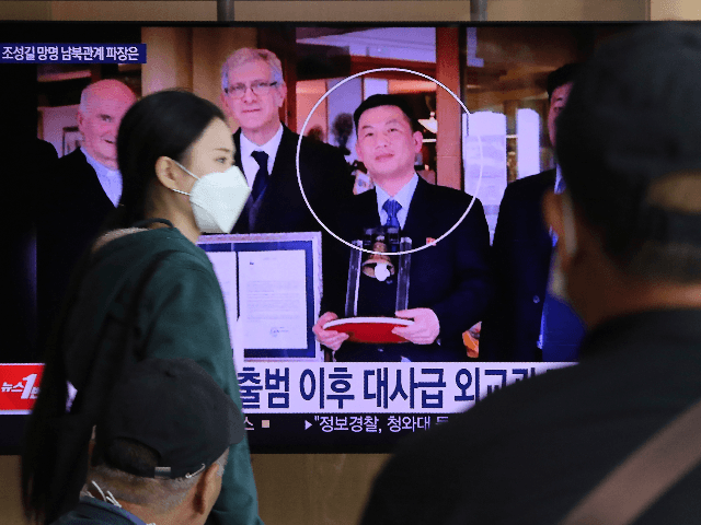 People watch a TV showing an image of Jo Song Gil, the North Korea's former ambassador to Italy, right, during a news program at the Seoul Railway Station in Seoul, South Korea, Wednesday, Oct. 7, 2020. Jo who had vanished in Italy in late 2018, currently lives in South Korea …