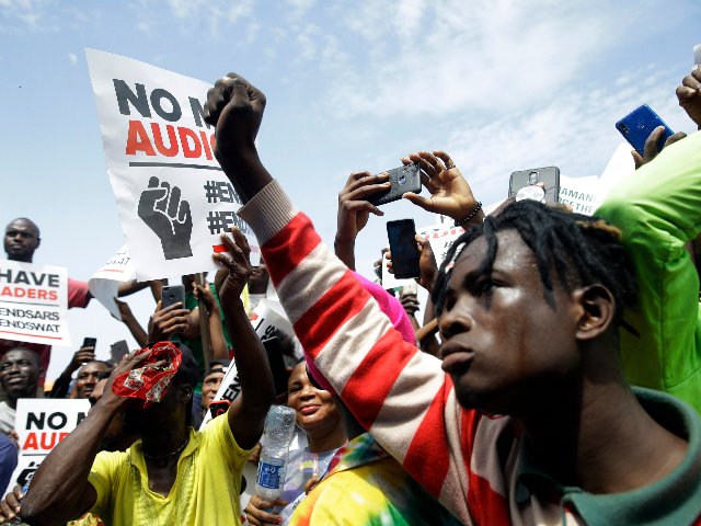 People hold banners as they demonstrate on the street to protest against police brutality in Lagos, Nigeria, Thursday Oct. 15, 2020. Protests against Nigeria's police continued to rock the country for the eighth straight day Thursday as demonstrators marched through the streets of major cities, blocking traffic and disrupting business. …
