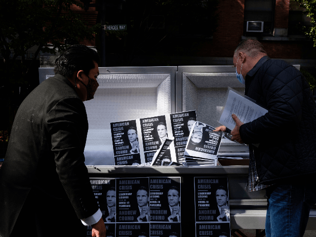 Silver Casket in Brooklyn Filled with 6,500 Covers of Gov. Andrew Cuomo's Book