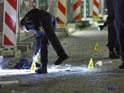 File---File picture taken Oct.5, 2020 shows criminal experts investigating a crime scene in Dresden, Germany. Two people died in a knife attack. The suspect that was arrested on Tuesday is known as a possible person in context of islamistic terrorists. (Roland Halkasch/dpa via AP, file)