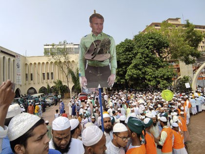 Supporters of Islami Andolan Bangladesh, an Islamist political party, carry a cutout of French President Emmanuel Macron with a garland of footwear around it as they protest against the publishing of caricatures of the Prophet Muhammad they deem blasphemous, in Dhaka, Bangladesh, Tuesday, Oct. 27, 2020. Muslims in the Middle …