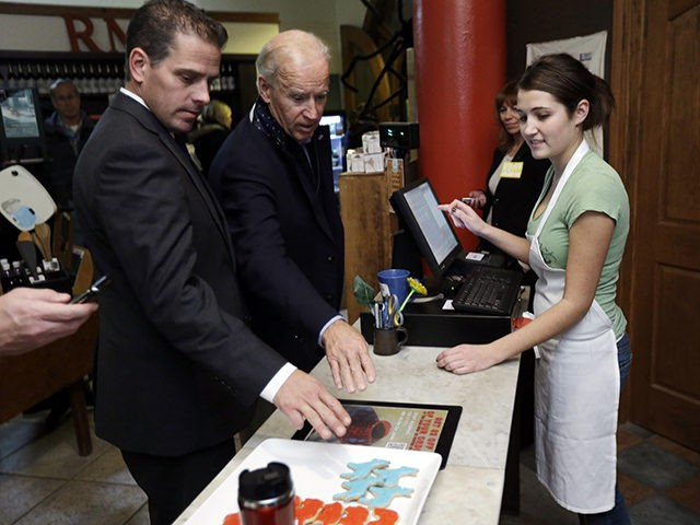 Vice President Joe Biden, accompanied by his son Hunter Biden places an order for a blue Democratic donkey cookies during a visit to the Red Mug Friday, Nov. 2, 2012, in Superior, Wis. (AP Photo/Matt Rourke)