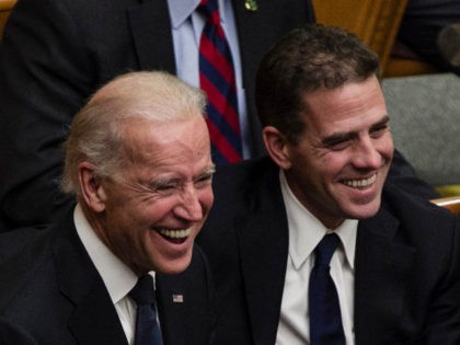 From right, Tom Daschle, Hunter Biden, Vice President Joe Biden, and daughters of George McGovern Ann McGovern and Susan Rowen, laugh as they listen to Matt McGovern, grand son of George McGovern, at a prayer service for the former Democratic U.S. senator and three-time presidential candidate George McGovern at the …