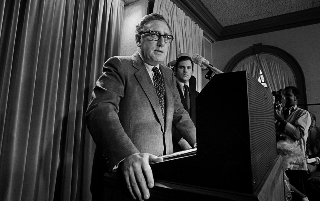 """** FILE ** In this Oct. 26, 1972 file photo, then presidential adviser Dr. Henry Kissinger tells a White House news conference that """"peace is at hand in Vietnam. (AP Photo)"""
