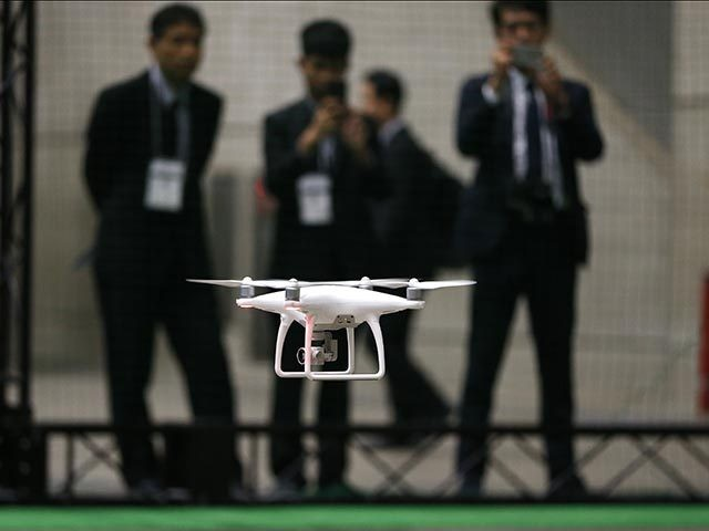 Chinese consumer-drone maker DJI's Phantom 4 flies during a demonstration at Japan Drone expo at Makuhari Messe event hall in Chiba, near Tokyo, Friday, March 25, 2016. The drone which has propellers, cameras, sensors and automatic tracking technology, zipped around and followed a stunt bicycle-rider, successfully dodging a signboard. (AP …